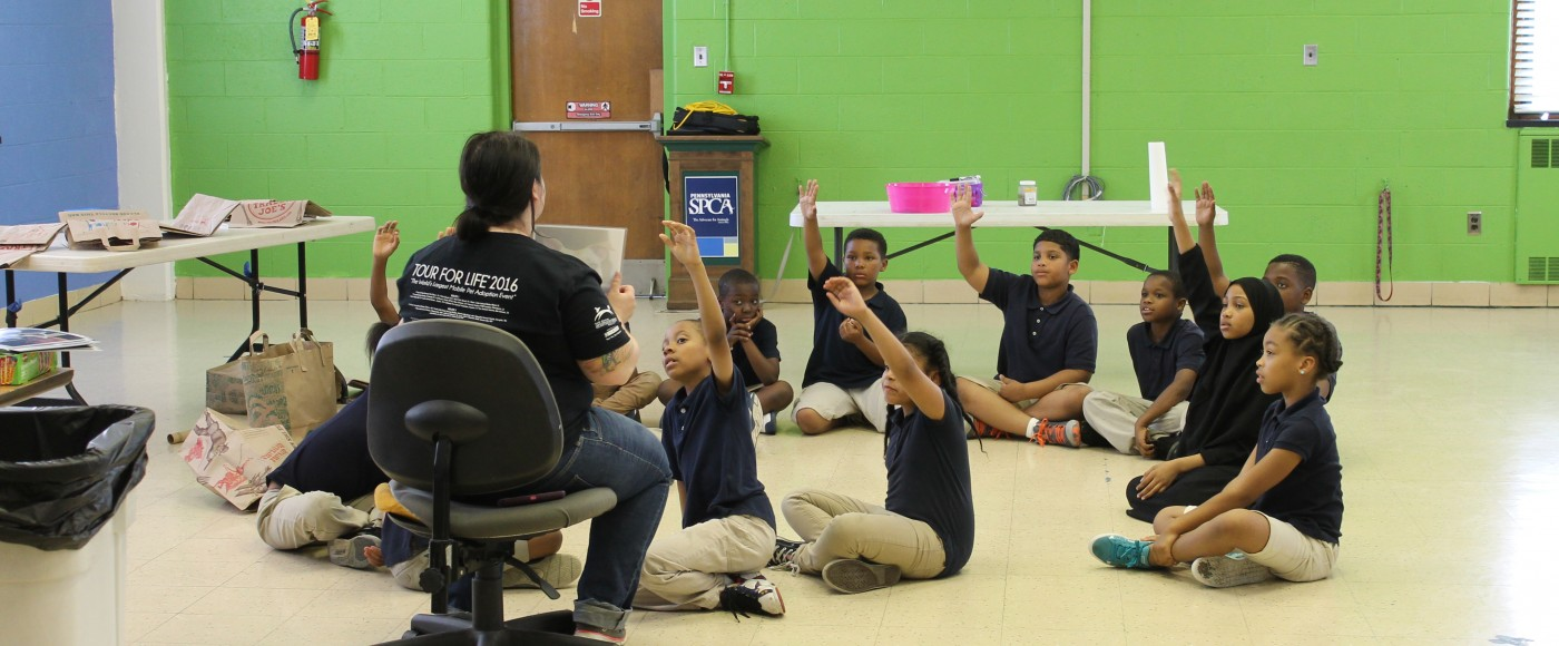 Humane Education discusses pet body language with group of young school kids